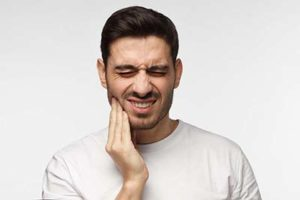 man in pain and in need of Dental Injury Treatment