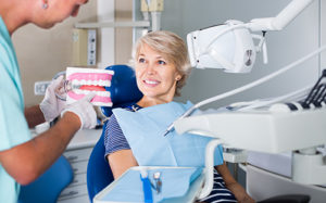 woman getting fitted for dentures
